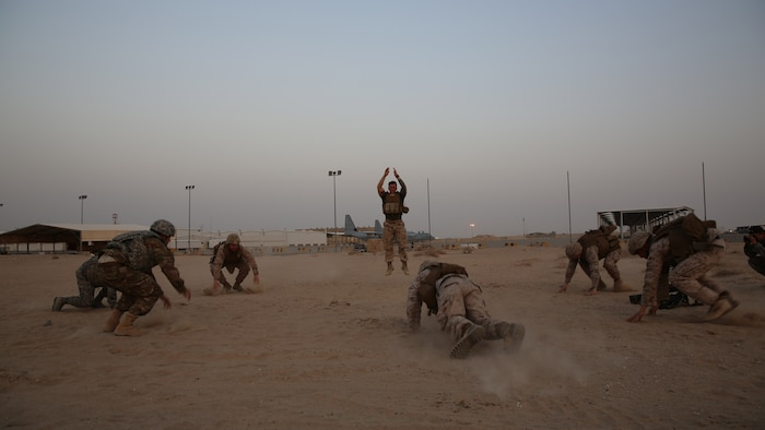 Navy corpsmen with the Ground Combat Element, Special Purpose Marine Air-Ground Task Force-Crisis Response-Central Command put Airmen and Marines through a strenuous workout before leading them into their final evaluation during a Combat Life Saver course in Southwest Asia, Aug. 12, 2015. During the final test the students work in pairs and each pair is given a different scenario where they must assess, treat and pass along a patient to a follow-on medical provider. The SPMAGTF corpsmen provide a three-day CLS course teaching combat triage and emergency trauma care to improve the survivability of the Crisis Response Company and coalition partners.