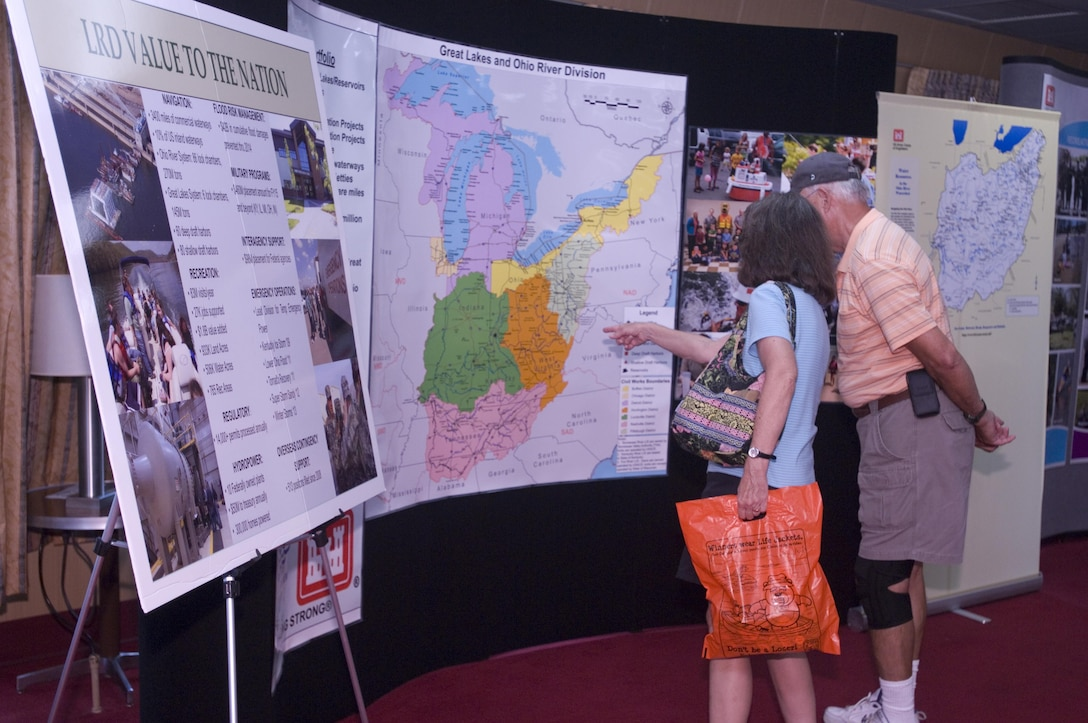 A couple looks at a display about the Great Lakes and Ohio River Division onboard the Motor Vessel Mississippi during a public tour of the vessel docked at Ross's Landing in Chattanooga, Tenn., Aug. 7, 2015. The M/V Mississippi spends more than 90 percent of its time as a working towboat, moving barges, equipment and supplies on the lower Mississippi River.  The M/V Mississippi, built in 1993 by Halter Marine, is the fifth Army Corps of Engineers towboat to bear the name.  It is the largest diesel towboat in the United States at 241-feet long, 58-feet wide and five stories high.  Three 2,100-horsepower diesel engines power the vessel.