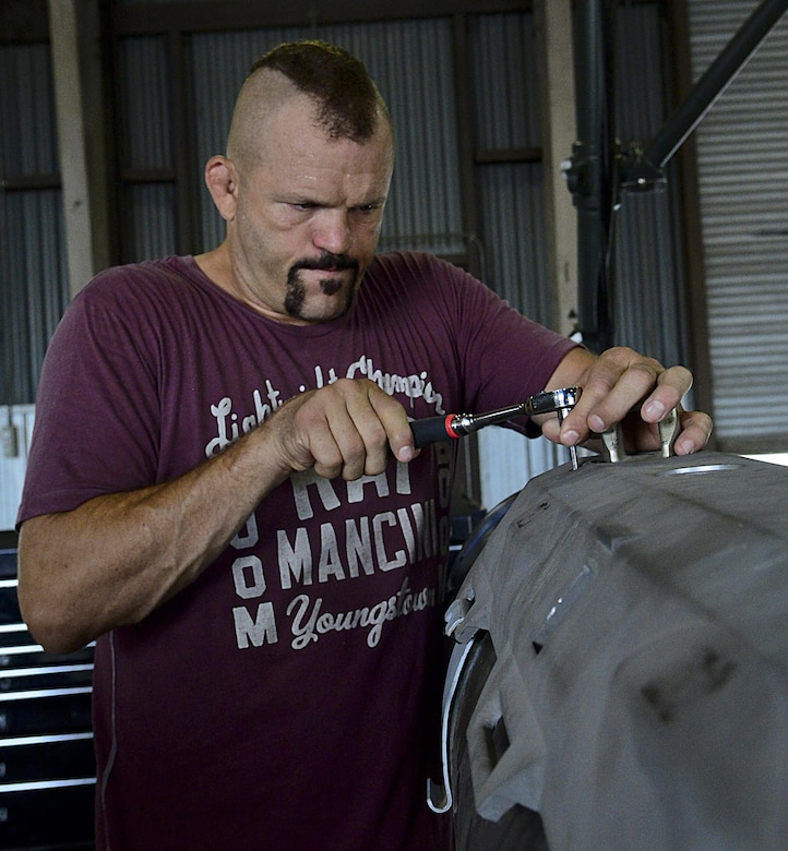 """Chuck """"The Iceman"""" Liddell, a retired American mixed martial artist, tightens a bolt on a guided bomb unit-31 on Osan Air Base, South Korea, Aug. 5, 2015. Liddell visited various units across the base during a morale trip. Liddell is a former Ultimate Fighting Championship light heavyweight champion. He has an extensive striking background in Kempo, Koei-Kan karate, and kickboxing, as well as a grappling background in collegiate wrestling and Brazilian Jiu-Jitsu. (U.S. Air Force photo/Senior Airman Kristin High)"""