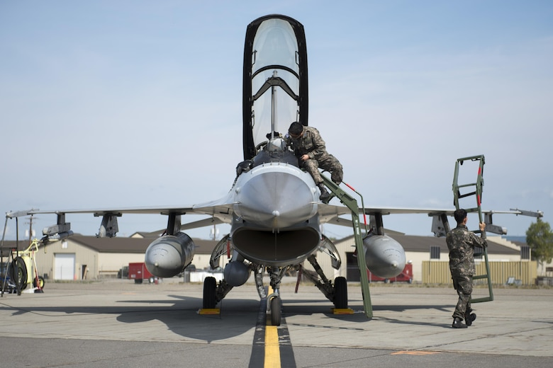 Members of the South Korean air force inspect their F-16D Fighting Falcon prior to launch at Eielson Air Force Base, Alaska, Aug. 4, 2015. The South Korean air force is participating in RF-A 15-3, a Pacific Air Forces field training exercise for U.S. and partner nation forces, providing combined offensive counter-air, interdiction, close air support and large force employment training in a simulated combat environment. (U.S. Air Force photo/1st Lt. Elias Zani)