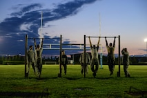 Airmen prepare for chin-ups during an Army pre-Ranger physical assessment, Aug. 5, 2015, at Aviano Air Base, Italy. The assessment included a 5-mile run, pushups, situps and chin-ups. (U.S. Air Force photo/Staff Sgt. Evelyn Chavez)