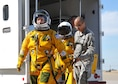Secretary of the Air Force Deborah Lee James walks to a U-2S as Senior Airman Aaron Saenz, a 9th Physiological Support Squadron launch and recovery technician, carries the high-altitude pressure suit auxiliary equipment at Beale Air Force Base, Calif., Aug. 11, 2015. The specialized pressure suit allows U-2S pilots to safely fly at altitudes reaching 70,000 feet. James visited Beale AFB to receive a first-hand perspective of high-altitude intelligence, surveillance and reconnaissance from collection to dissemination. (U.S. Air Force photo/Senior Airman Dana J. Cable)