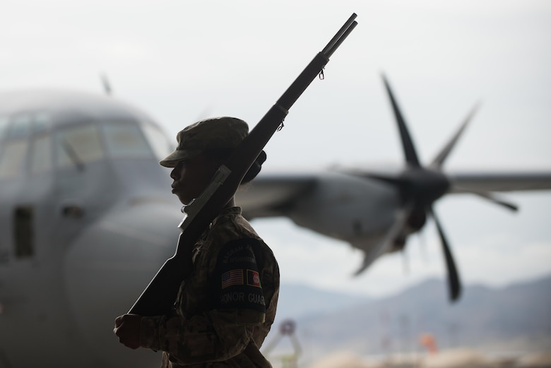An Airman with the Bagram Airfield Honor Guard participates in the 455th Expeditionary Mission Support Group change of command ceremony at Bagram Airfield, Afghanistan, Aug. 3, 2015. The 455th MSG is comprised of five squadrons responsible for communications, civil engineer operations, force support, logistics readiness and security forces. (U.S. Air Force photo/Tech. Sgt. Joseph Swafford)