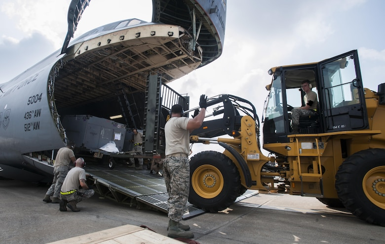 Airmen from the 39th Logistics Readiness Squadron and the 728th Air Mobility Squadron unload equipment from a C-5M Super Galaxy from Dover Air Force Base, Del., in support of Operation Inherent Resolve Aug. 9, 2015, at Incirlik Air Base, Turkey. The Air Force deployed six F-16 Fighting Falcons from Aviano Air Base, Italy, support equipment, and approximately 300 personnel to Incirlik AB. (U.S. Air Force photo/Senior Airman Krystal Ardrey)