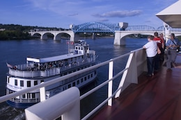 The Southern Belle passes by the Motor Vessel Mississippi during a public tour of the vessel docked at Ross's Landing in Chattanooga, Tenn., Aug. 7, 2015. The M/V Mississippi spends more than 90 percent of its time as a working towboat, moving barges, equipment and supplies on the lower Mississippi River.  The M/V Mississippi, built in 1993 by Halter Marine, is the fifth Army Corps of Engineers towboat to bear the name.  It is the largest diesel towboat in the United States at 241-feet long, 58-feet wide and five stories high.  Three 2,100-horsepower diesel engines power the vessel.