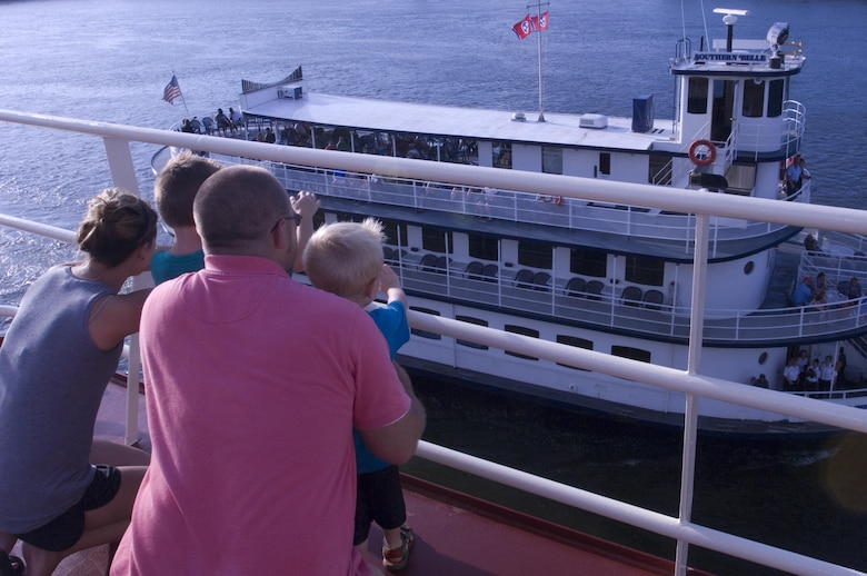 A family watches the Southern Belle pass by from their vantage point on the Motor Vessel Mississippi during a public tour of the vessel docked at Ross's Landing in Chattanooga, Tenn., Aug. 7, 2015. The M/V Mississippi spends more than 90 percent of its time as a working towboat, moving barges, equipment and supplies on the lower Mississippi River.  The M/V Mississippi, built in 1993 by Halter Marine, is the fifth Army Corps of Engineers towboat to bear the name.  It is the largest diesel towboat in the United States at 241-feet long, 58-feet wide and five stories high.  Three 2,100-horsepower diesel engines power the vessel.