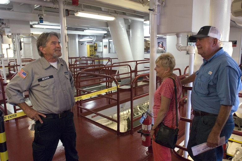 Walker Mohon (Left) welcomes visitors to the engine room of the Motor Vessel Mississippi during a public tour of the vessel docked at Ross's Landing in Chattanooga, Tenn., Aug. 7, 2015. The M/V Mississippi spends more than 90 percent of its time as a working towboat, moving barges, equipment and supplies on the lower Mississippi River.  The M/V Mississippi, built in 1993 by Halter Marine, is the fifth Army Corps of Engineers towboat to bear the name.  It is the largest diesel towboat in the United States at 241-feet long, 58-feet wide and five stories high.  Three 2,100-horsepower diesel engines power the vessel. The vessel is the U.S. Army Corps of Engineers' largest diesel towboat and flagship to the Mississippi River Commission, which is inspecting Corps of Engineers projects along the Tennessee River as part of the commission's annual low water inspection trip.
