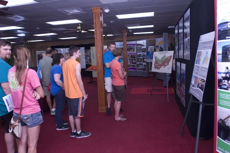 Visitors look at displays about the U.S. Army Corps of Engineers Nashville District, Great Lakes and Ohio River Division, and Tennessee Valley Authority onboard the Motor Vessel Mississippi during a public tour of the vessel docked at Ross's Landing in Chattanooga, Tenn., Aug. 7, 2015. The M/V Mississippi spends more than 90 percent of its time as a working towboat, moving barges, equipment and supplies on the lower Mississippi River.  The M/V Mississippi, built in 1993 by Halter Marine, is the fifth Army Corps of Engineers towboat to bear the name.  It is the largest diesel towboat in the United States at 241-feet long, 58-feet wide and five stories high.  Three 2,100-horsepower diesel engines power the vessel.