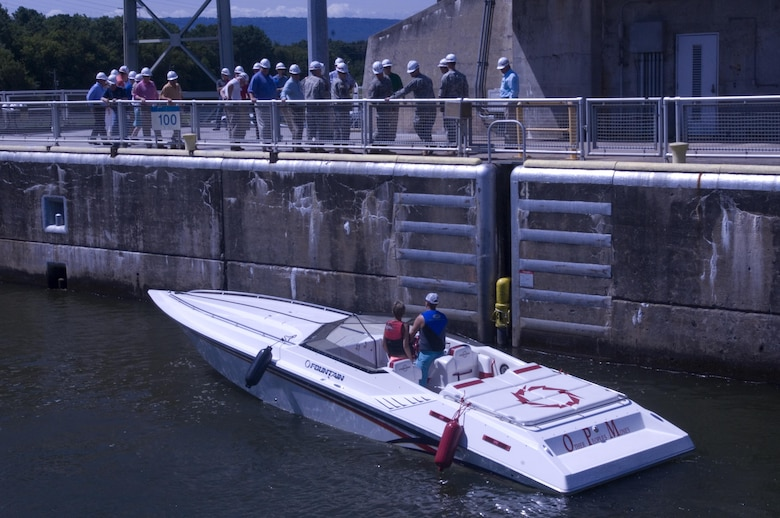 A recreational vessel locks through Chickamauga Lock in Chattanooga, Tenn., Aug. 8, 2015 while the Mississippi River Commission, Corps of Engineers officials and local stakeholders tour the lock.  The commission is on a low water inspection of the Tennessee River.