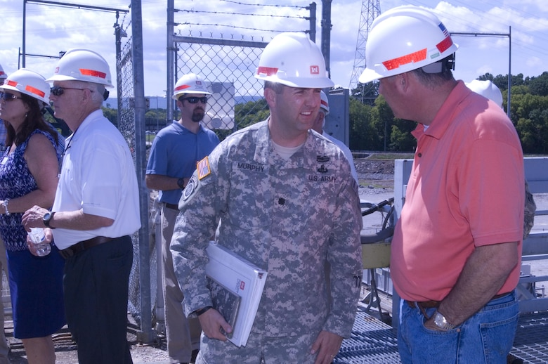 Lt. Col. Stephen F. Murphy, U.S. Army Corps of Engineers Nashville District commander, talks with stakeholders while the Mississippi River Commission visits Chickamauga Lock on the Tennessee River in Chattanooga, Tenn., Aug. 8, 2015.