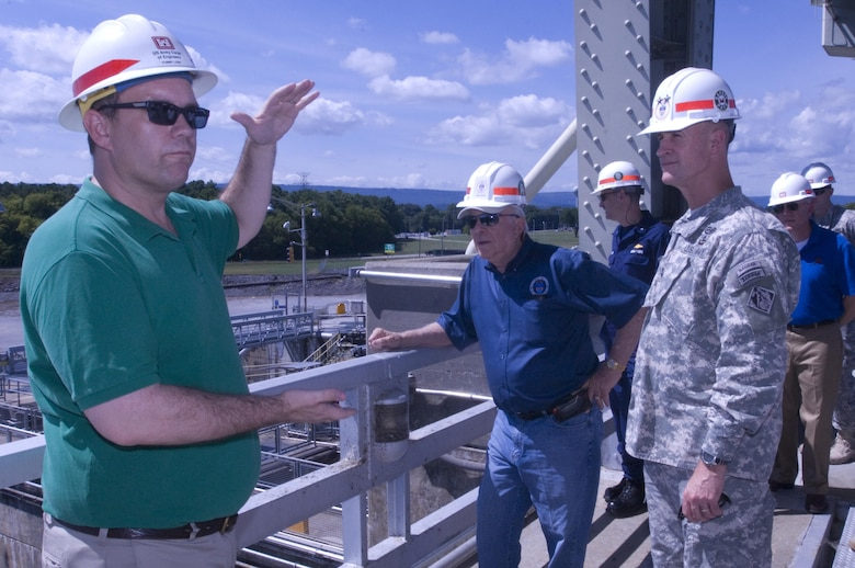 Tommy Long (Green Shirt), resident engineer for the Chickamauga Lock Replacement Project, briefs Maj. Gen. Michael C. Wehr, Mississippi Valley Division commander, during a visit to the lock Aug. 8, 2015 in his capacity as the president of the Mississippi River Commission.  The Honorable Sam E. Angel, civilian member of the commission, is also listening to Long.  The commission is on a low water inspection of the Tennessee River. Long works in the U.S. Army Corps of Engineers Nashville District Engineering and Construction Division.