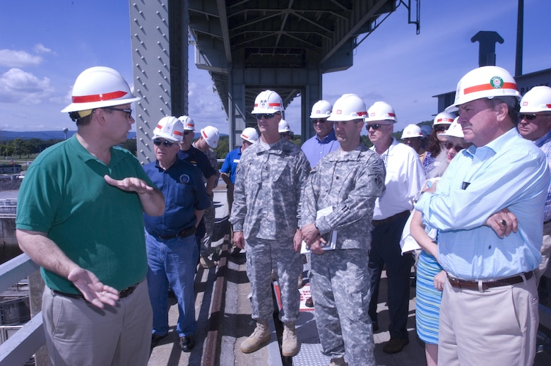 Tommy Long (Green Shirt), resident engineer for the Chickamauga Lock Replacement Project, briefs the Mississippi River Commission at the lock Aug. 8, 2015.  The commission is on a low water inspection of the Tennessee River. Long works in the U.S. Army Corps of Engineers Nashville District Engineering and Construction Division.