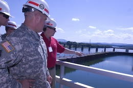 Don Getty (Red Shirt), project manager for the Chickamauga Lock Replacement Project, briefs Brig. Gen. Richard G. Kaiser, U.S. Army Corps of Engineers Great Lakes and Ohio River Division commander, during a visit to the lock Aug. 8, 2015 in his capacity as a member of the Mississippi River Commission.  The commission is on a low water inspection of the Tennessee River. Getty works in the U.S. Army Corps of Engineers Nashville District Project Planning Branch.