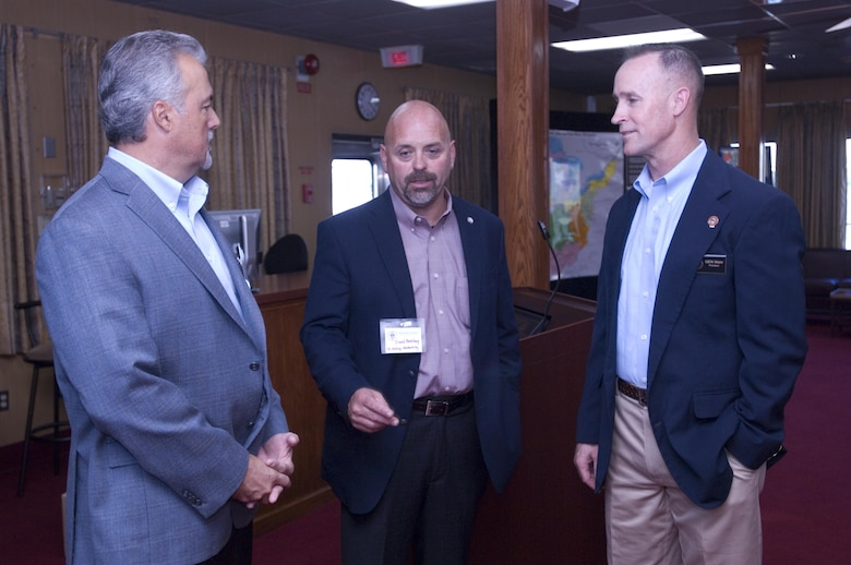 Maj. Gen. Michael C. Wehr (Right), Mississippi Valley Division commander and president of the Mississippi River Commission, speaks with David Bowlira (Center) and John McCormick of the Tennessee Valley Authority during a stakeholder social onboard the Motor Vessel Mississippi while docked at Ross's Landing in Chattanooga, Tenn., Aug. 8, 2015. The commission is on a low water inspection of the Tennessee River and works to have a dialogue with community leaders along the waterway.