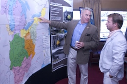 Brig. Gen. Richard G. Kaiser (Left), U.S. Army Corps of Engineers Great Lakes and Ohio River Division commander, speaks with Jeff Lewis, field representative for Tennessee Sen. Lamar Alexander, during a stakeholder social onboard the Motor Vessel Mississippi while docked at Ross's Landing in Chattanooga, Tenn., Aug. 8, 2015. The commission is on a low water inspection of the Tennessee River and works to have a dialogue with community leaders along the waterway.