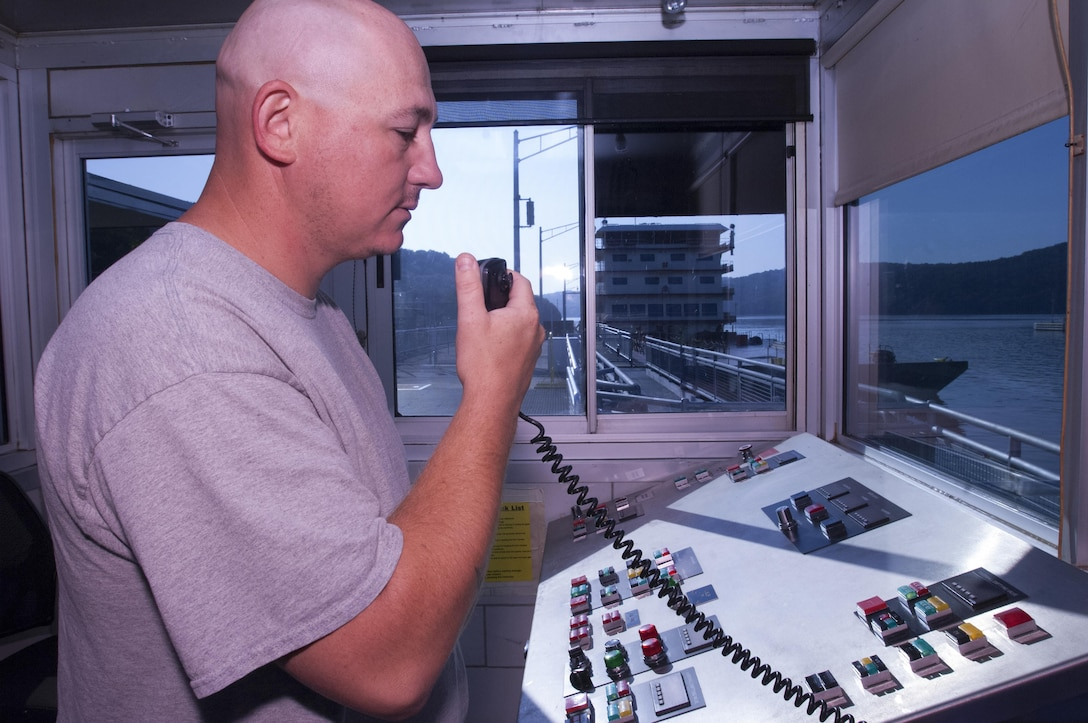 Lock Operator Brandon Smith communicates with the Motor Vessel Mississippi captain as the towboat prepares to lock through Guntersville Lock in Grant, Ala., the morning of Aug. 9, 2015.  The lock, which is located at Tennessee River Mile 349, is maintained and operated by the U.S. Army Corps of Engineers Nashville District.  The vessel is transporting the Mississippi River Commission, which is conducting a low water inspection of the Tennessee River.