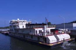 Motor Vessel Mississippi locks through Guntersville Lock in Grant, Ala., the morning of Aug. 9, 2015.  The lock, which is located at Tennessee River Mile 349, is maintained and operated by the U.S. Army Corps of Engineers Nashville District.  The vessel is transporting the Mississippi River Commission, which is conducting a low water inspection of the Tennessee River.