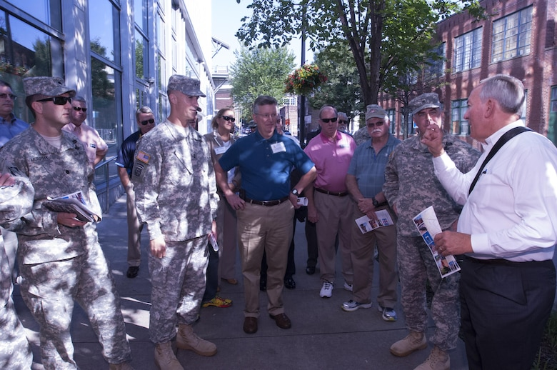 Roger Lindsey (Right), professional engineer and program manager for Metro Nashville Water Services, talks about how the city responded during the May 2010 flood during a walking tour of the city of Nashville, Tenn.  Several members of the Mississippi River Commission and local stakeholders took the tour Aug. 12, 2015.