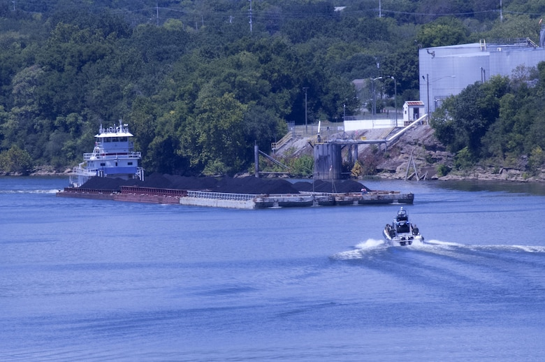 A Nashville Metro Police vessel approaches a barge tow full of coal headed for the Gallatin Steam Plant on the Cumberland River in Nashville, Tenn., Aug. 12, 2015.  The photo was taken from the Motor Vessel Mississippi as it approached from the opposite direction with a group of stakeholders headed to Cheatham Lock and Dam in Ashland City, Tenn.  The stakeholders were onboard to interact with the Mississippi River Commission in the process of conducting a low water inspection of the Cumberland River.