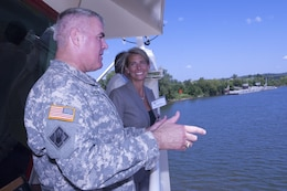 Brig. Gen. Richard G. Kaiser, U.S. Army Corps of Engineers Great Lakes and Ohio River Division, talks with Sonia Allman, Nashville Metro Water Services, onboard the Motor Vessel Mississippi in Nashville, Tenn., Aug. 12, 2015.  Kaiser was interacting with stakeholders during a low water inspection trip on the Cumberland River in the Nashville District area of operations.