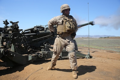Corporal Alredo Mireles, a field artillery cannoneer with Battery B, 2nd Battalion, 11th Marine Regiment, 1st Marine Division, fires an M777 Howitzer during Summer Fire Exercise 15, aboard Marine Corps Base Camp Pendleton, Calif., Aug. 13, 2015. The exercise, which spans Aug. 6-17, provides an opportunity for Marines to practice standing operating procedures for coordinating and executing fire missions in preparation for future operations. (U.S. Marine Corps photo by Cpl. Demetrius Morgan/RELEASED)
