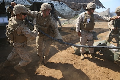 Marines with Battery B, 2nd Battalion, 11th Marine Regiment, 1st Marine Division load an M777 Howitzer during Summer Fire Exercise 15, aboard Marine Corps Base Camp Pendleton, Calif., Aug. 13, 2015. The exercise, which spans Aug. 6-17, provides an opportunity for Marines to practice standing operating procedures for coordinating and executing fire missions in preparation for future operations. (U.S. Marine Corps photo by Cpl. Demetrius Morgan/RELEASED)