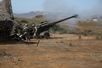 Marines with Battery B, 2nd Battalion, 11th Marine Regiment, 1st Marine Division fire an M777 Howitzer during Summer Fire Exercise 15, aboard Marine Corps Base Camp Pendleton, Calif., Aug. 13, 2015. The exercise, which spans Aug. 6-17, provides an opportunity for Marines to practice standing operating procedures for coordinating and executing fire missions in preparation for future operations.(U.S. Marine Corps photo by Cpl. Demetrius Morgan/RELEASED)