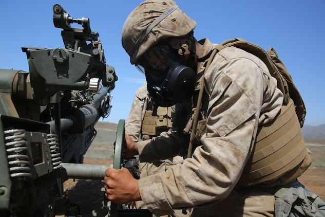A Marine with Battery B, 2nd Battalion, 11th Marine Regiment, 1st Marine Division adjusts an M777 Howitzer during Summer Fire Exercise 15, aboard Marine Corps Base Camp Pendleton, Calif., Aug. 13, 2015. The exercise, which spans Aug. 6-17, provides an opportunity for Marines to practice standing operating procedures for coordinating and executing fire missions in preparation for future operations. (U.S. Marine Corps photo by Cpl. Demetrius Morgan/RELEASED)