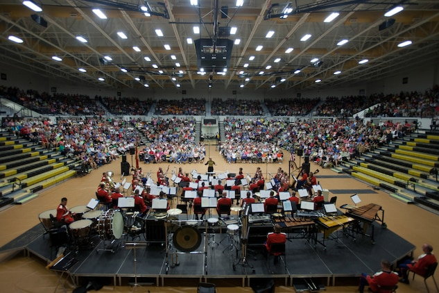 "On Sept. 6, 2014, the Marine Band performed at Jasper High School in Indiana while on its National Concert Tour. Hometowner and Jasper High School alum Gunnery Sgt. Brad Weil performed Kenny Baker's ""Virtuosity"" as a soloist. Photo credit Caitlin O'Hara/The Herald"