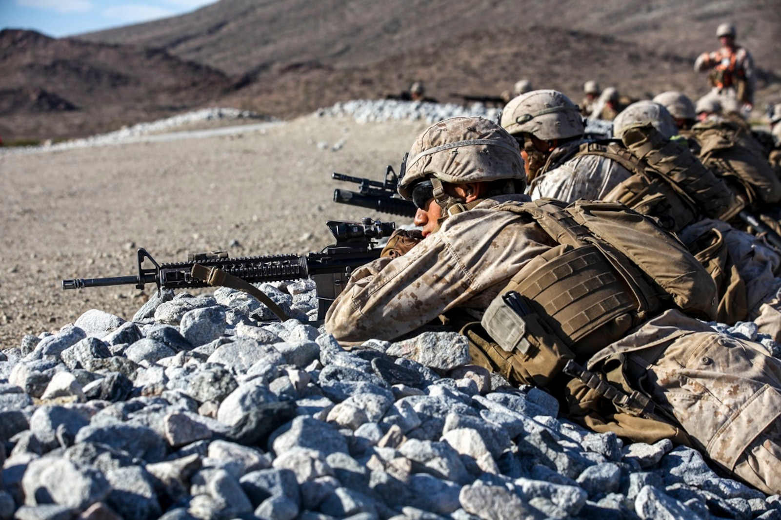 Marines with Company A, 1st Battalion, 7th Marine Regiment, provide security during a Military Operation on Urban Terrain exercise aboard Marine Corps Air Ground Combat Center Twentynine Palms, California, Aug. 11, 2015. The MOUT exercise was part of an Integrated Training Exercise that allowed the Marines with Animal Company to showcase their different capabilities in preparation for future deployments.