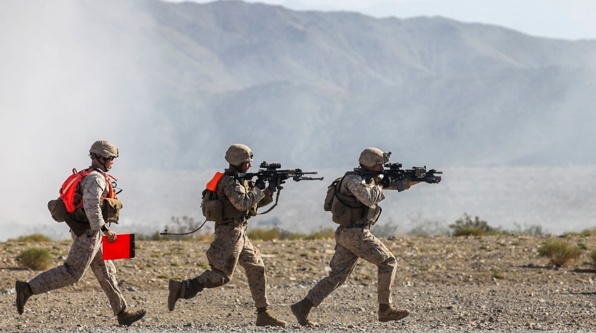 Marines with Company A, 1st Battalion, 7th Marine Regiment, rush from building to building during a Military Operation on Urban Terrain exercise aboard Marine Corps Air Ground Combat Center Twentynine Palms, California, Aug. 11, 2015. The MOUT exercise was part of an Integrated Training Exercise that allowed the Marines with Animal Company to showcase their different capabilities in preparation for future deployments.