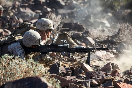 Marines with Company A, 1st Battalion, 7th Marine Regiment, provide suppressing fire during a Military Operation on Urban Terrain exercise aboard Marine Corps Air Ground Combat Center Twentynine Palms, California, Aug. 11, 2015. The MOUT exercise was part of an Integrated Training Exercise that allowed the Marines with Animal Company to showcase their different capabilities in preparation for future deployments.
