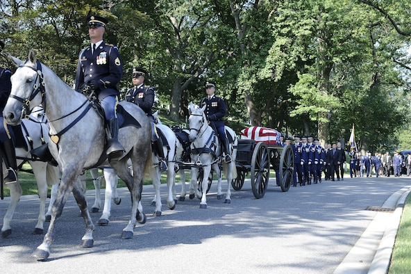 Members of the Old Guard escort the ninth Chief Master Sgt. of the Air Force James C. Binnicker to rest in Arlington National Cemetery, Va., Aug. 14, 2015. Binnicker passed away March 21 in Calhoun, Ga. (U.S. Air Force photo/Senior Airman Preston Webb)