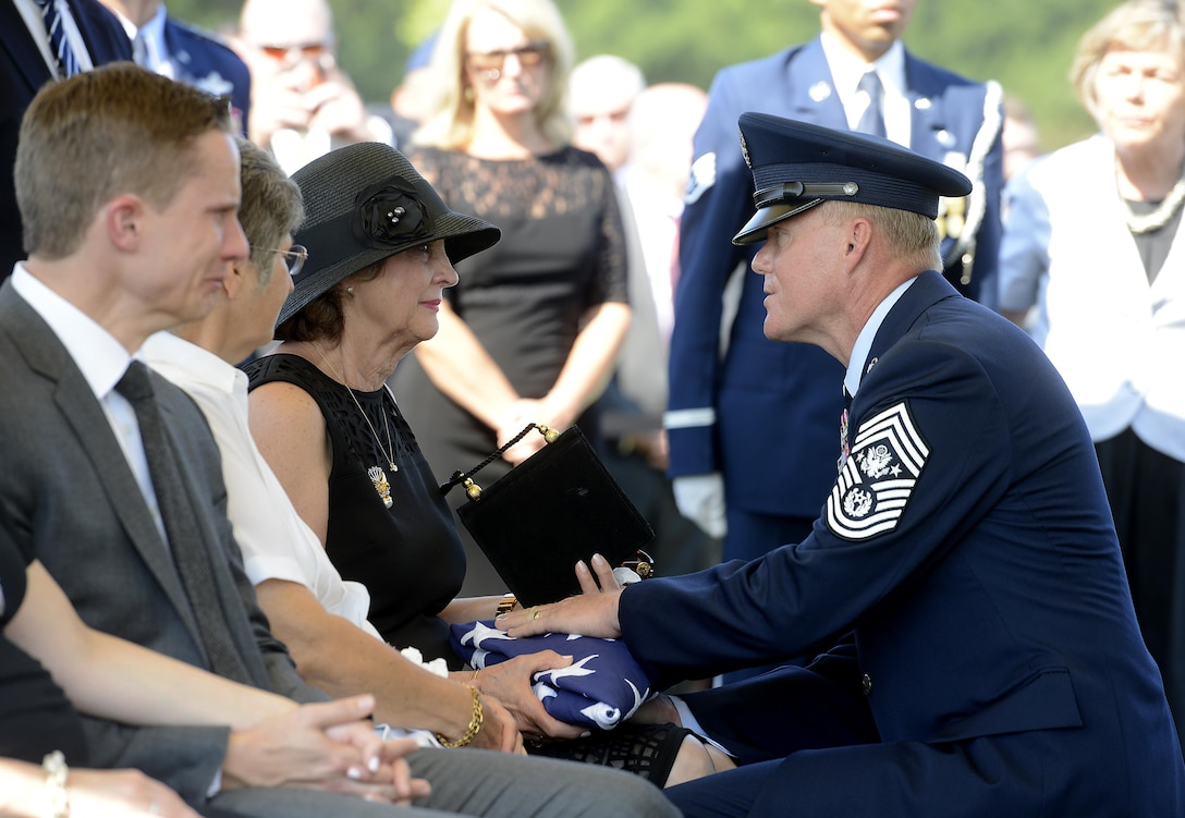 Chief Master Sgt. of the Air Force James A. Cody consoles Jan Binnicker, widow of ninth Chief Master Sgt. of the Air Force James Binnicker, before he is laid to rest in Arlington National Cemetery, Va., Aug. 14, 2015. Binnicker passed away March 21 in Calhoun, Ga. (U.S. Air Force photo/Scott M. Ash)