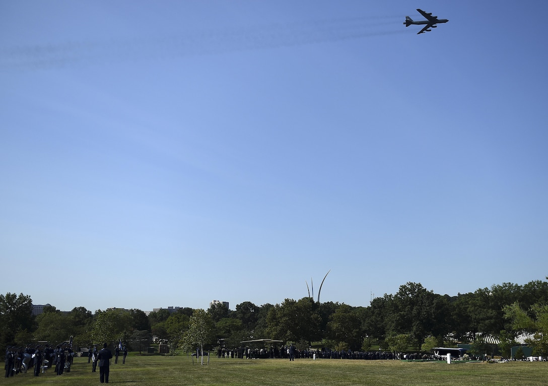 A B-52 Stratofortress flies over Arlington National Cemetery, Va., in honor of ninth Chief Master Sgt. of the Air Force James Binnicker before he is laid to rest Aug. 14, 2015. Binnicker passed away March 21 in Calhoun, Ga. (U.S. Air Force photo/Tech. Sgt. Dan DeCook)