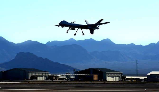 An MQ-9 Reaper performs touch-and-go flight patterns June 13, 2014, at Creech Air Force Base, Nev. The Reaper is an armed, multi-mission, medium-altitude, long-endurance remotely piloted aircraft that is employed primarily as an intelligence-collection asset and secondarily against dynamic execution targets. (U.S. Air Force photo/Senior Master Sgt. Cecilio Ricardo)