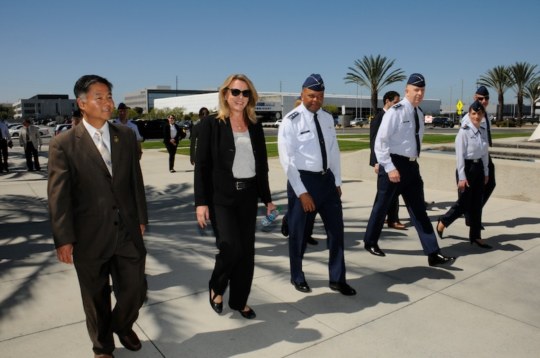 The Honorable Deborah Lee James, Secretary of the Air Force and U.S. Representative Ted Lieu, California 33rd congressional district are escorted by Lt. Gen. Samuel Greaves, Space and Missile Systems Center commander and Air Force Program Executive Officer for space, Maj. Gen. Robert McMurry, SMC vice commander, Col. Donna Turner, 61st Air Base Group commander and Chief Master Sgt. Craig Hall, SMC command chief during a visit to Los Angeles Air Force Base in El Segundo, Calif. Aug. 12. (U.S. Air Force photo/Joseph Juarez)