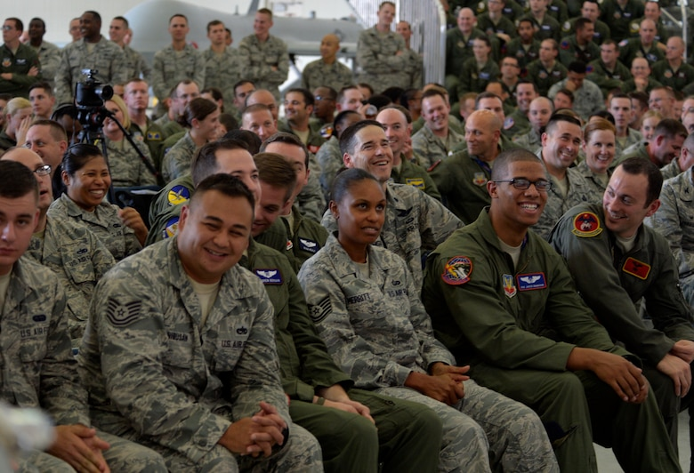 Members of Creech Air Force Base laugh during an all-call by Army Gen. Martin E. Dempsey, Chairman of the Joint Chiefs of Staff, Aug. 12, 2015, at Creech Air Force Base, Nevada. During his visit to Creech AFB, Dempsey and his wife Deanie toured the base to ask the Creech Airmen questions. (U.S. Air Force photo by Airman 1st Class Christian Clausen/Released)
