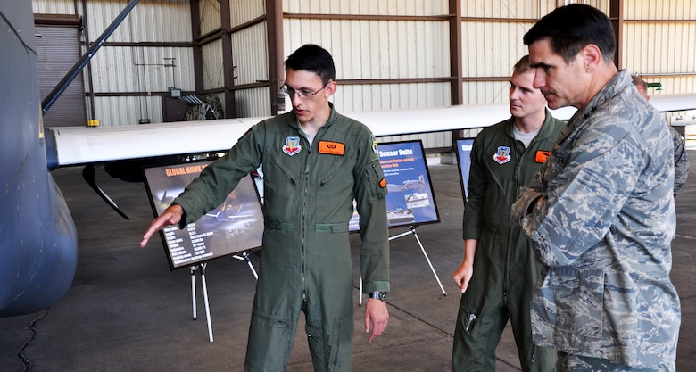 "Maj. Gen. Bradford ""B.J."" Shwedo (right), 25th Air Force commander, is briefed by Senior Airman Anthony on the capabilities of the RQ-4 Global Hawk aircraft  Aug. 13, 2015, at Beale Air Force Base, California. The visit to Beale was Shwedo's first since assuming command of the 25th Air Force. The 25th Air Force includes the 9th Reconnaissance Wing, the 7th, 363rd, and 480th Intelligence, Surveillance and Reconnaissance Wings; the 55th Wing and the Air Force Technical Applications Center. (U.S. Air Force photo by Jeffrey M. Schultze)"