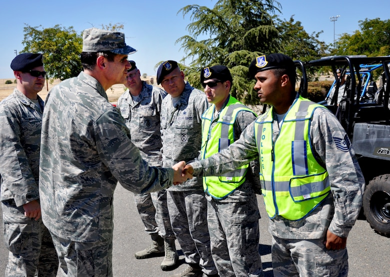 "Maj. Gen. Bradford ""B.J."" Shwedo, 25th Air Force commander, greets Tech. Sgt. Jordan Locklear, 9th Security Forces Squadron craftsman Aug. 12, 2015, at Beale Air Force Base, California. The visit to Beale was Shwedo's first since assuming command of the 25th Air Force. The 25th Air Force includes the 9th Reconnaissance Wing, the 70th, 363rd and 480th Intelligence, Surveillance and Reconnaissance Wings; the 55th Wing and the Air Force Technical Applications Center. (U.S. Air Force photo by Jeffrey M. Schultze)"