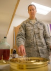 U.S. Air Force Staff Sgt. Jen Vahalik, the 354th Fighter Wing NCO in-charge of chapel plans and programs, prepares communion prior to a service July 29, 2015, in the Base Chapel at Eielson Air Force Base, Alaska. Vahalik assists chaplains, who help provide moral and spiritual growth opportunities for the military community and their dependents.  (U.S. Air Force photo by Staff Sgt. Shawn Nickel/Released)