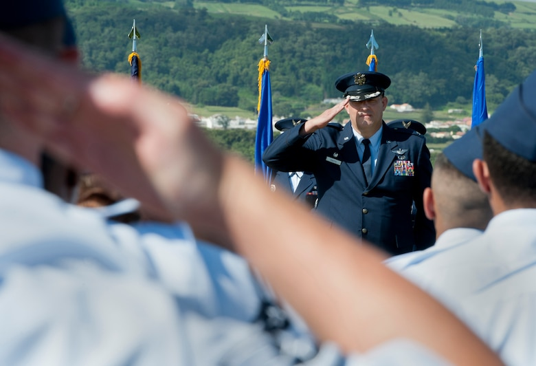 Col. Richard Sheffe, commander of the 65th Air Base Group, is saluted by members of the 65th Air Base Group, during a Redesignation Ceremony on Lajes Field, Azores, Portugal, August 14, 2015. With this Redesignation Ceremony the 65th Air Base Group is now aligned under the 86th Airlift Wing and remains positioned to provide agile combat support and services to aircraft and aircrews. (U.S. Air Force photo by Master Sgt. Bradley C. Church)