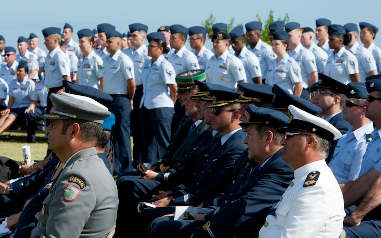 Members of the Portuguese military and U.S. Air Force watch the 65th Air Base Wing's Redesignation Ceremony on Lajes Field, Azores, Portugal, August 14, 2015. The ceremony redesignated the 65th Air Base Wing into the 65th Air Base Group aligned under the 86th Airlift Wing, Ramstein Air Base, Germany. (U.S. Air Force photo by Master Sgt. Bradley C. Church)