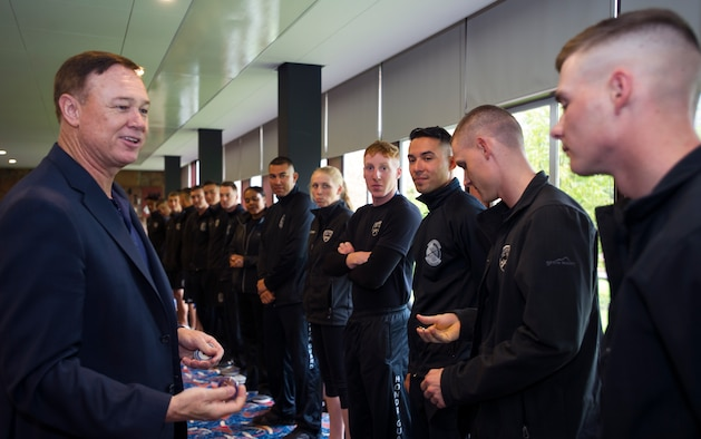 Maj. Gen. Darryl Burke, Air Force District of Washington commander, speaks with members of the United States Air Force Honor Guard Drill Team in Edinburgh, Scotland, Aug. 14, 2015. The honor guard was recognized for their participation in The Royal Edinburgh Military Tattoo. 20 members of the U.S. Honor Guard Drill team traveled to the United Kingdom to represent the USAF and the Department of Defense as the only branch of military service from the U.S. performing in the tattoo. The 66th production of the tattoo welcomed more than 220,000 spectators from around the world for a span of more than three weeks. (U.S. Air Force photo/Staff Sgt. Nichelle Anderson/released)