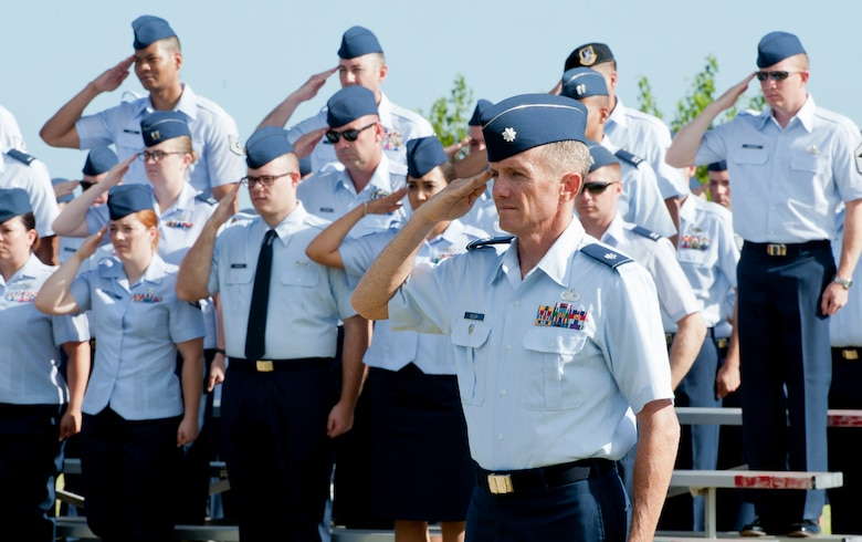 Lt. Col. Brian Belson, deputy commander of the 65th Air Base Group, salutes during the 65th Air Base Wing's Redesignation Ceremony on Lajes Field, Azores, Portugal, August 14, 2015. With this Redesignation Ceremony the 65th Air Base Group is now aligned under the 86th Airlift Wing and remains positioned to provide agile combat support and services to aircraft and aircrews. (U.S. Air Force photo by Master Sgt. Bradley C. Church)