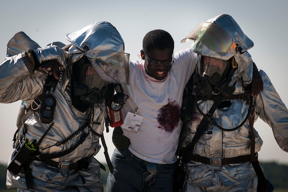 Senior Airman Christopher Springs, exercise volunteer, gets carried off the flight line on Joint Base Andrews, Md., during an emergency-readiness exercise Aug. 13, 2015. Exercise volunteers with mock injuries role-played during the exercise to create a realistic training environment. (U.S. Air Force photo/Airman 1st Class Philip Bryant)