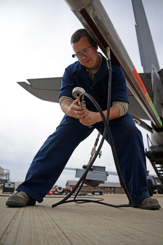 U.S. Air Force Senior Airman Robert Summerville, 100th Maintenance Squadron hydraulics technician from New Castle, Penn., services KC-135 Stratotanker surge boots as part of a required inspection, Aug. 11, 2015, on RAF Mildenhall, England. Surge boots are rubber-like sleeves that run the length of the fuel tube, used as a way to prevent damage during fuel surges when the boom disconnects from the aircraft it is refueling. (U.S. Air Force photo by Senior Airman Christine Halan/Released)