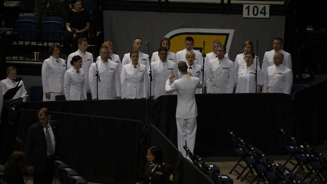 Members of the U.S. Navy Sea Chanters sing at the McKenzie Arena during the Chattanooga memorial service at the University of Tennessee at Chattanooga, Aug. 15. Four Marines and one sailor died during a shooting in Chattanooga, Tennessee, July 16, 2015.