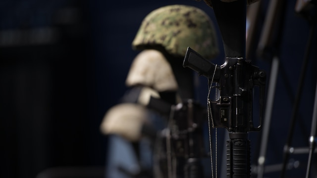 Battle crosses are mounted on stage at the McKenzie Arena at the University of Tennessee at Chattanooga, Aug. 15. The battle crosses are symbolic replacements for crosses for service members who have fallen in the line of duty. Four Marines and one sailor died during a shooting in Chattanooga, Tennessee, July 16, 2015.