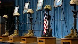 Battle crosses are mounted on stage at the Mckenzie Arena at the University of Tennessee at Chattanooga, Aug. 15, 2015. The battle crosses are symbolic replacements for crosses for service members who have fallen in the line of duty. Four Marines and one sailor died during a shooting in Chattanooga, Tennessee, July 16, 2015.